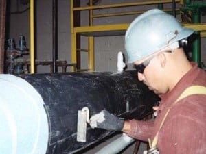 Insulrap being applied to an insulated line with RG-2400® underneath (food processing plant)
