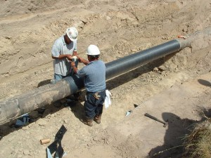 Installing outerwrap over vapor barrier membrane.